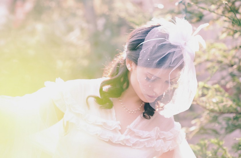 Tulle birdcage veil & feather flower